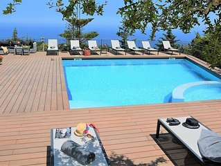 Beautiful villa surrounded by palm trees and gardens with sea views, a wide terr