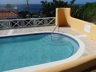 Luxury townhouse with pool, spectacular sea views, 5 minutes walk from beach