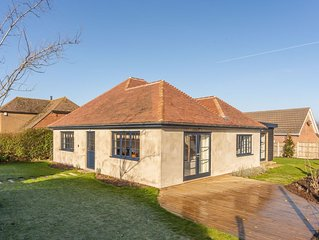Set in large private gardens, this bungalow has undergone a total transformation