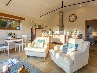An idyllic and stylish single-storey barn conversion for two.