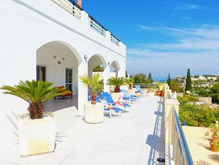 Villa comprising of an exquisite terrace with seaview overlooking pool & gardens