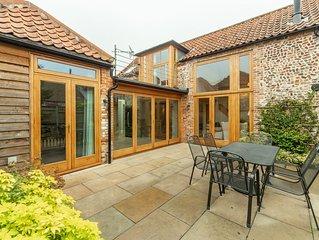 This luxury bespoke barn conversion is quietly located near Burnham Market.