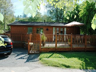 Log cabin with private hot tub on shores of Lake Windermere, Lake District