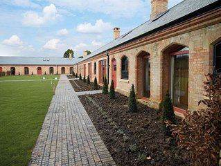 The Dairy, on the Burghley Estate, luxury accommodation for 14 guests in Capabil