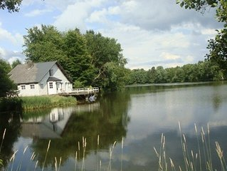 Charming cottage in front of a big private lake