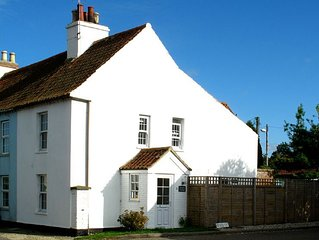 Pretty white-washed three bedroom cottage with distant marsh views
