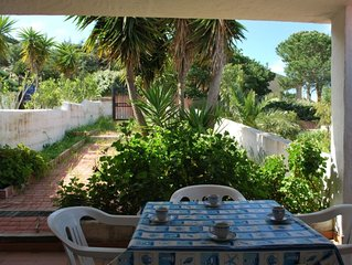 Villetta con giardino recintato, vista mare in Res. con piscina