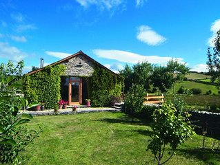 This detached barn conversion offers panoramic views over stunningly beautiful c