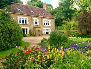 Puckhams sits  in its own beautiful mature gardens to the front and rear with fi