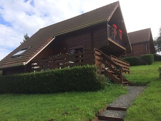 Traditional Log Cabin on quiet Residential Site with communal Heated Pool