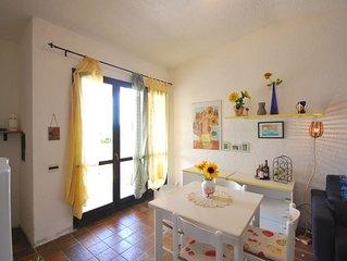 Villetta con giardino privato in residence, ingresso gratis in piscina