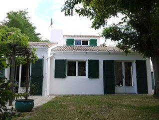 Large comfortable house, 150m from stunning beach.