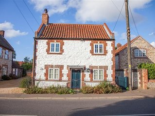 A three-bedroom cottage renovated to a very high standard in central Thornham. T