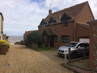 Stunning detached cottage 50 feet from the beach