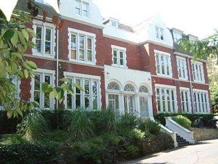 Impressive 2 bedroom, 2 bathroom ground floor flat with private decking & garden