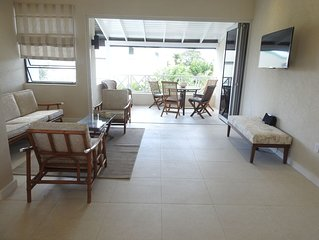 Modern luxury condo with seaviews, pool, close to beach. Wi-fi. Great location.