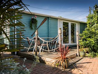 Log Cabin next to our sandy beach with lovely sea views, close Norfolk Broads.