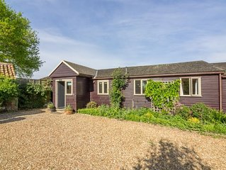 This charming wooden cottage is just 15 minutes from the coast.