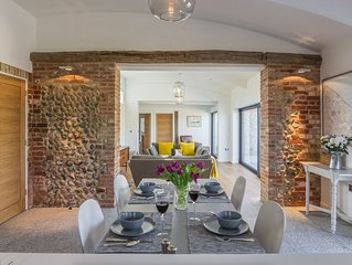 Big Sky Barn is a contemporary conversion of a 200 year old brick and flint barn
