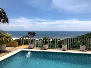 Hermosa casa de playa con vista al mar.