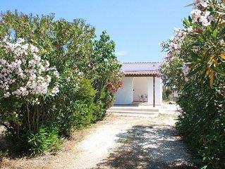 Villa con ampio giardino confinante con parco Bidderosa