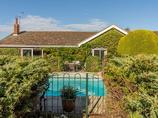 A spacious holiday home in Brancaster Staithe with a heated swimming pool.