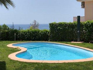 Appartamento in villa con piscina e giardino sul mare panoramica su due livelli