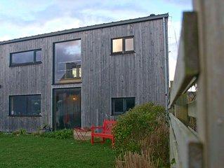 Maison de vacances en bois, cosy, en bord de mer, à 100 m des plages et sentiers