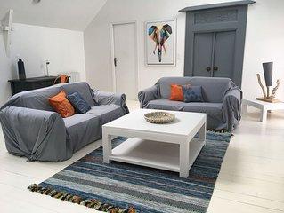 Appartement avec jardinet  dans maison en pierre