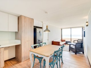Contemporary apartment w/ a full kitchen, ocean views, & rooftop deck