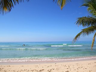 Comfortable 1 Bedroom Vacation Rental - Just steps from the tropical beach!
