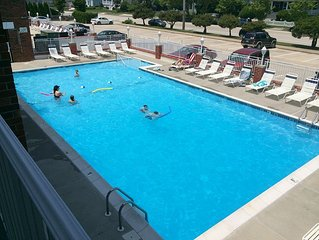 Bright, clean,  renovated 1BR condo! Overlooks heated pool, 1/2 blk to beach!