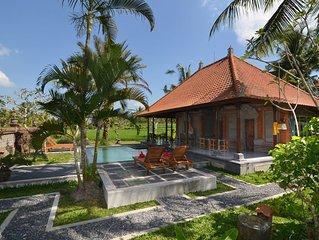 Villa balinaise dans les rizières à proximité à pieds du centre d'Ubud.