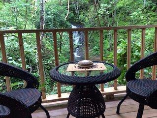 Wood Cabin Facing Natural Waterfall