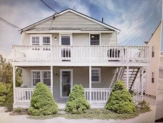Completely renovated first floor condo half block from the beach