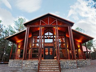 Luxurious two-story cabin built with a large family or a large group in mind.