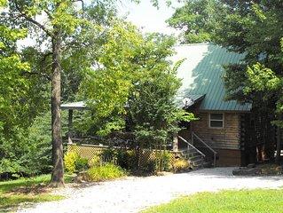 Deer Cabin Of Deer Lodge Cabin Rentals is a Secluded Ozark Cedar Log Cabin