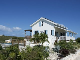 Flame Tree Cottage | Private home with pool and ocean view | 1/2 mile to beach