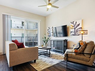 Modern retreat right downtown w/ shared pool & private washer/dryer