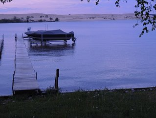 Water access, dock slip, view of lake & dunes, big yard, quiet & peaceful