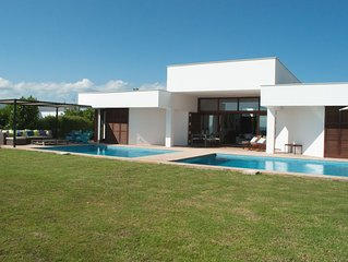 Stunning contemporary luxury villa with sea views, garden, large swimming pool.