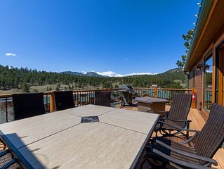 Outdoor deck with fire pit. Cliffside with Rocky Mountain views