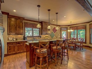 Spectacular Craftsman Style home in beautiful gated neighborhood on the lake