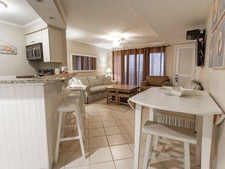Luxury Bayfront 2BR Condo, Sleeps 6-8, indoor pool,  1 block walk to beach