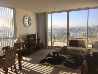 """Top Floor Luxury """"Skyview""""- 2 bedroom Apartment – City Skyline view."""