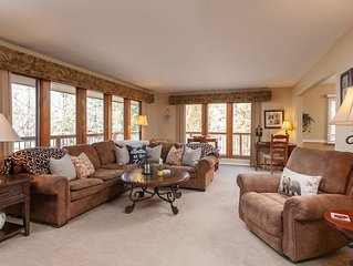 ACROSS FROM LAKE!  LOADED w/AMENITIES - JACUZZI, POOL TABLE, PAC MAN, PING PONG!