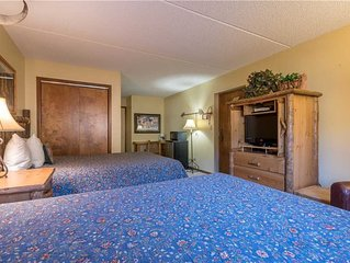 Hotel w/ 2 queen beds, great value, hot tub, sauna, free wifi, & parking.