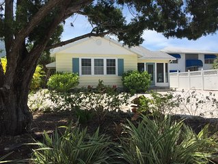 Vintage cottage less than a block from beautiful Lido Beach and Pool!