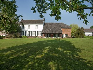 Traditional half-timbered farmhouse in the beautiful, hilly landscape of South-