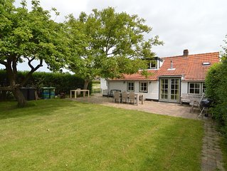 Warmly decorated holiday home with wonderful garden near the beach.